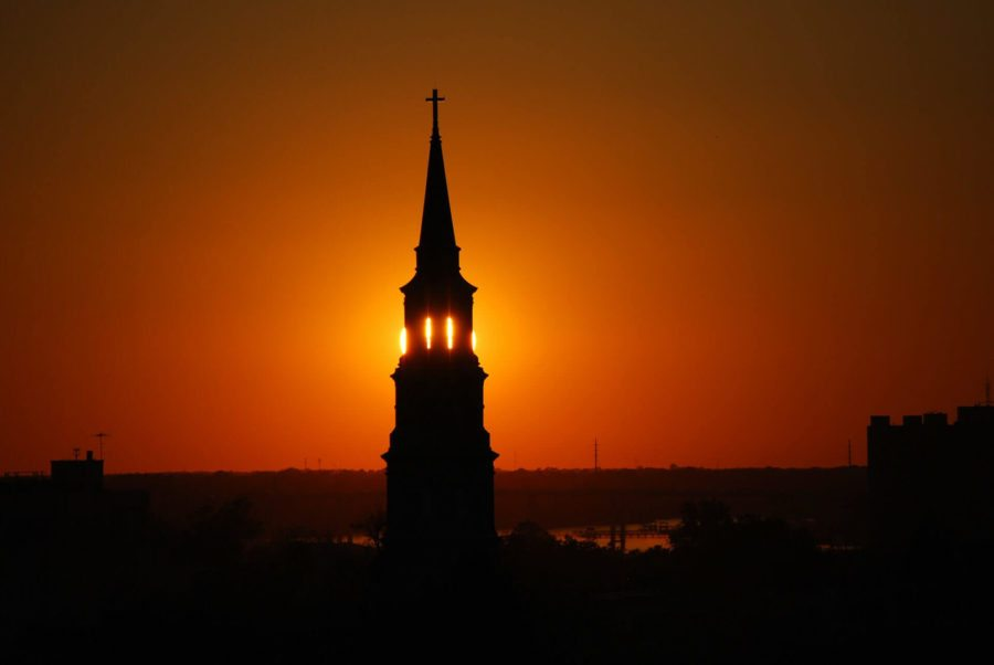 sunset over st philip's episcopal church in historic downtown charleston, sc