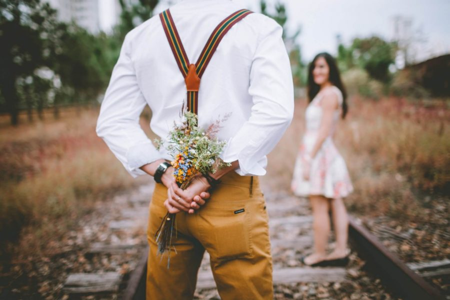 man about to surprise his girlfriend with flowers on romantic weekend getaways in Charleston, SC
