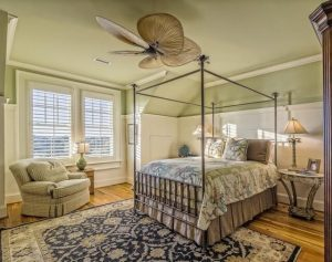 a bedroom of one of the most romantic bed and breakfasts in charleston, south carolina's historic district
