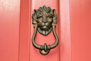 door knocker on a door in the south of broad neighborhood, you can find it on one of the best charleston walking tours