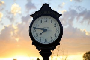 clock on East Montague Avenue in Park Circle, North Charleston, SC, in front of a sunset